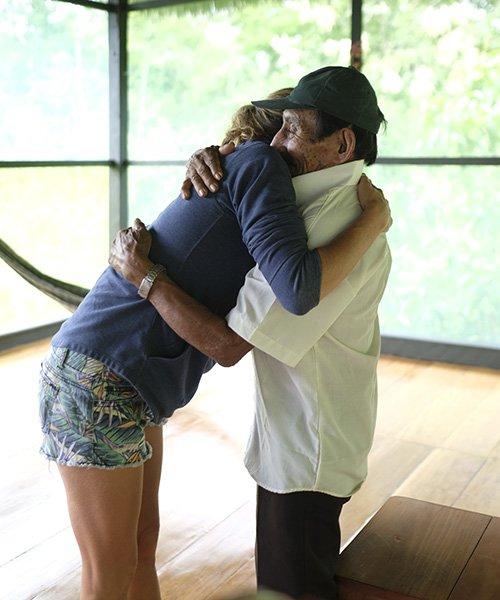 ayahuasca retreat happy guest shaman hug