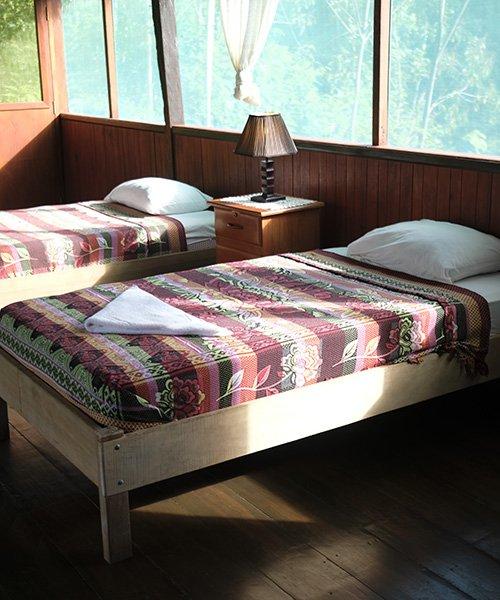 kawsay ayahuasca retreat guest bedroom beds lamp