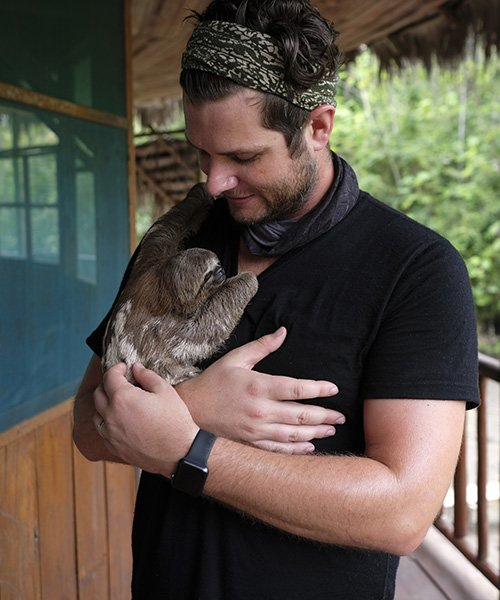 ayahuasca retreat happy guest with sloth
